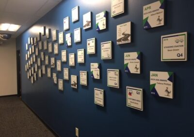 staff achievements posted on wall